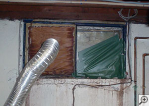 A basement window system that's rotted and  has been damaged over time in Franklin.
