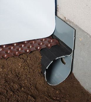 Closeup of a crawl space drainage system installed in Wilmington