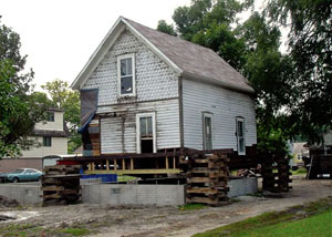 A severely damaged home foundation that is undergoing replacement in Dayton.