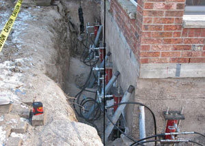 Foundation push piers installed around a house with a foundation settlement issues in Lawrenceburg
