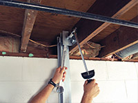 Straightening a foundation wall with the PowerBrace™ i-beam system in a Jeffersonville home.
