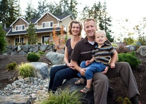 A happy family outside a home with a repaired foundation in Madison