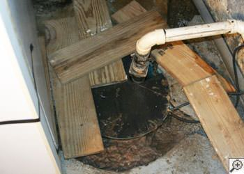 An ugly, clogged sump pump system in Fairfield, Ohio and Indiana