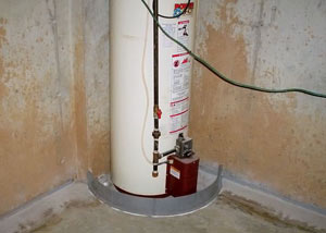 A water heater in Milford that's been protected by the FloodRing® and a perimeter drain system.