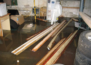 A severely flooding basement in Fairborn, with lumber and personal items floating in a foot of water