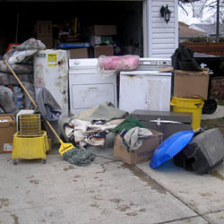 Soaked, wet personal items sitting in a driveway, including a washer and dryer in Fairfield.