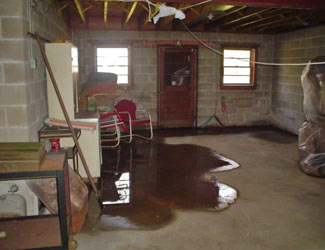 a flooded basement floor in a Englewood home