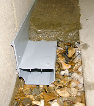 A basement drain system installed in a Fairfield home