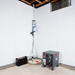 Sump pump system, dehumidifier, and basement wall panels installed during a sump pump installation in Miamisburg