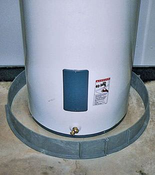 An old water heater in Monroe, OH and IN with flood protection installed