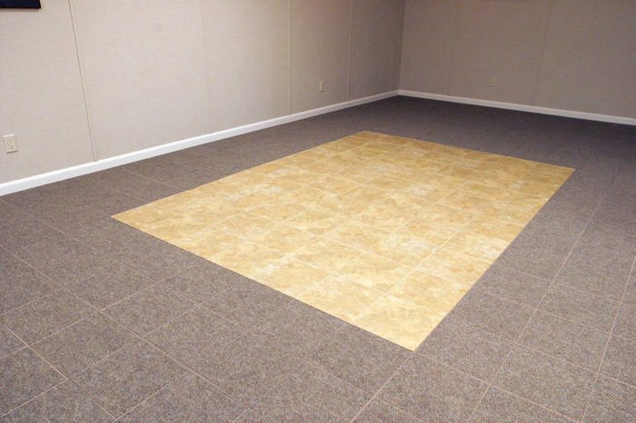 tiled and carpeted basement flooring installed in a Middletown home